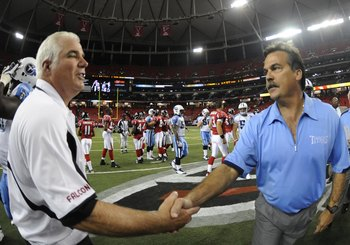 ATLANTA - AUGUST 22: Coach Jeff Fisher (right) of the Tennessee Titans and coach Mike Smith of the Atlanta Falcons shake hands after play at the Georgia Dome on August 22, 2008 in Atlanta, Georgia.  (Photo by Al Messerschmidt/Getty Images)