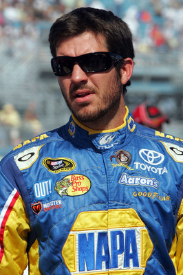 HOMESTEAD, FL - NOVEMBER 21:  Martin Truex Jr., driver of the #56 NAPA Toyota, stands on the grid prior to the NASCAR Sprint Cup Series Ford 400 at Homestead-Miami Speedway on November 21, 2010 in Homestead, Florida.  (Photo by Jerry Markland/Getty Images
