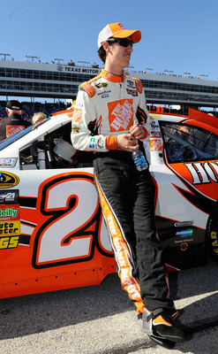 FORT WORTH, TX - NOVEMBER 07:  Joey Logano, driver of the #20 Home Depot Toyota, stands on the grid prior to the NASCAR Sprint Cup Series AAA Texas 500 at Texas Motor Speedway on November 7, 2010 in Fort Worth, Texas.  (Photo by John Harrelson/Getty Image