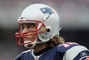 FOXBORO, MA - JANUARY 02:  Tom Brady #12 of the New England Patriots looks on in the first half against the Miami Dolphins on January 2, 2011 at Gillette Stadium in Foxboro, Massachusetts.  (Photo by Elsa/Getty Images)