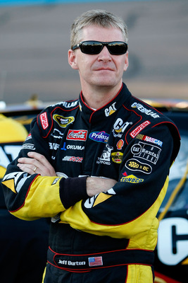 AVONDALE, AZ - NOVEMBER 12: Jeff Burton, driver of the #33 Caterpillar Chevrolet, stands on pit road during qualifying for the NASCAR Sprint Cup Series Kobalt Tools 500 at Phoenix International Raceway on November 12, 2010 in Avondale, Arizona.  (Photo by