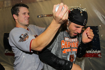 ARLINGTON, TX - NOVEMBER 01:  Buster Posey #28 and Madison Bumgarner #40 of the San Francisco Giants celebrate in the locker room after the Giants won 3-1 against the Texas Rangers in Game Five of the 2010 MLB World Series at Rangers Ballpark in Arlington