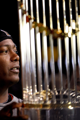 ARLINGTON, TX - NOVEMBER 01:  Series MVP Edgar Renteria #16 of the San Francisco Giants celebrates as he holds the World Series Championship trophy against the Texas Rangers in Game Five of the 2010 MLB World Series at Rangers Ballpark in Arlington on Nov