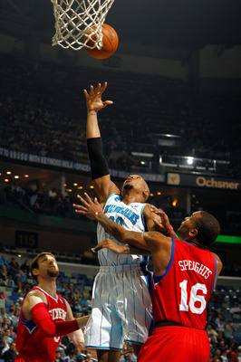 NEW ORLEANS, LA - JANUARY 03:  David West #30 of the New Orleans Hornets shoots the ball between Andres Nocioni #5 and Marreese Speights #16 of the Philadelphia 76ers in the first half at New Orleans Arena on January 3, 2011 in New Orleans, Louisiana. NOT