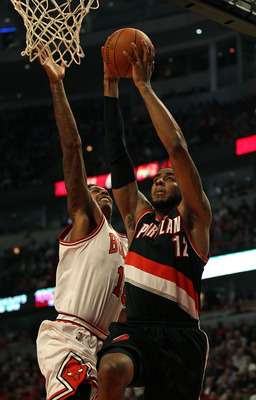 CHICAGO - NOVEMBER 01: LaMarcus Aldridge #12 of the Portland Trail Blazers goes up for a shot against James Johnson #16 of the Chicago Bulls at the United Center on November 1, 2010 in Chicago, Illinois. The Bulls defeated the Trail Blazers 110-98. NOTE T