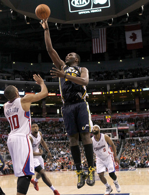 LOS ANGELES, CA - DECEMBER 29:  Al Jefferson #25 of the Utah Jazz shoots over Eric Gordon #10 of the Los Angeles Clippers at Staples Center on December 29, 2010 in Los Angeles, California.   The Jazz won 103-85.  NOTE TO USER: User expressly acknowledges