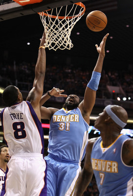 PHOENIX - NOVEMBER 15:  Nene #31 of the Denver Nuggets puts up a shot against the Phoenix Suns during the NBA game at US Airways Center on November 15, 2010 in Phoenix, Arizona.  The Suns defeated the Nuggets 100-94.  NOTE TO USER: User expressly acknowle