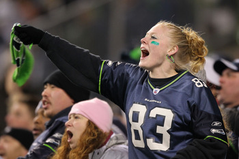 SEATTLE, WA - JANUARY 02:  A fan of the Seattle Seahawks cheers during their game against the St. Louis Rams at Qwest Field on January 2, 2011 in Seattle, Washington.  (Photo by Otto Greule Jr/Getty Images)