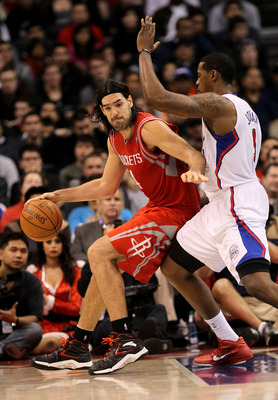 LOS ANGELES, CA - DECEMBER 22:  Luis Scola #4 of the Houston Rockets controls the ball against DeAndre Jordan #9 of the Los Angeles Clippers at Staples Center on December 22, 2010 in Los Angeles, California.  The Rockets won 97-92. NOTE TO USER: User expr