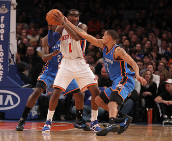 NEW YORK - DECEMBER 22:  Amar'e Stoudemire #1 of the New York Knicks in action against  the Oklahoma City Thunder at Madison Square Garden on December 22, 2010 in New York, New York.   NOTE TO USER: User expressly acknowledges and agrees that, by download