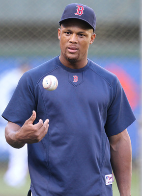 SEATTLE - SEPTEMBER 13:  Adrian Beltre #29 of the Boston Red Sox tosses the baseball during batting practice prior to the game against the Seattle Mariners at Safeco Field on September 13, 2010 in Seattle, Washington. (Photo by Otto Greule Jr/Getty Images