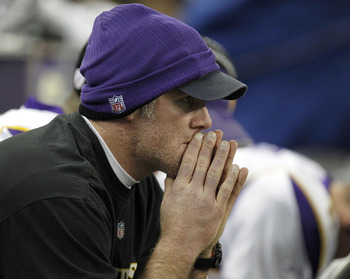 DETROIT, MI - JANUARY 02:  Brett Favre #4 of the Minnesota Vikings looks on from the bench while playing the Detroit Lions at Ford Field on January 2, 2011 in Detroit, Michigan.  (Photo by Gregory Shamus/Getty Images)