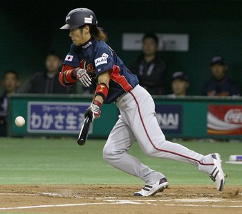 TOKYO, JAPAN - MARCH 3:  Infielder Tsuyoshi Nishioka #7 of Japan lays down a bunt during the first round match between Japan and China of the 2006 World Baseball Classic at the Tokyo Dome on March 3, 2006 in Tokyo, Japan.  (Photo by Koichi Kamoshida/Getty