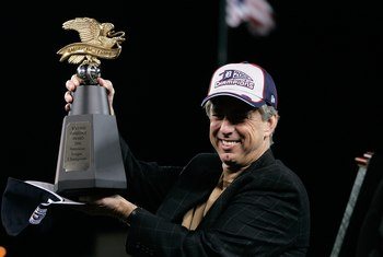 DETROIT - OCTOBER 14:  General Manager Dave Dombrowski of the Detroit Tigers holds the AMerican Championship Trophy after the Tigers won 6-3 against the Oakland Athletics during Game Four of the American League Championship Series October 14, 2006 at Come