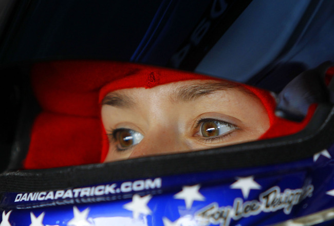 HOMESTEAD, FL - NOVEMBER 19:  Danica Patrick, driver of the #7 GoDaddy.com Chevrolet, sits in her car during practice for the NASCAR Nationwide Series Ford 300 at Homestead-Miami Speedway on November 19, 2010 in Homestead, Florida.  (Photo by Chris Trotma