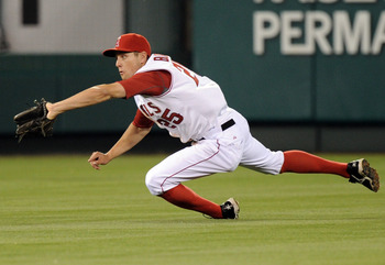 ANAHEIM, CA - AUGUST 13: Peter Bourjos #25 of the Los Angeles Angels makes a diving catch for an out of Aaron Hill #2 of the Toronto Blue Jays during the fourth inning at Angel Stadium on August 13, 2010 in Anaheim, California.  (Photo by Harry How/Getty