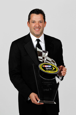 LAS VEGAS, NV - DECEMBER 03:  NASCAR driver Tony Stewart poses with his seventh place trophy during the NASCAR Sprint Cup Series awards banquet at the Wynn Las Vegas Hotel on December 3, 2010 in Las Vegas, Nevada.  (Photo by Todd Warshaw/Getty Images for