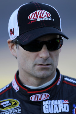 AVONDALE, AZ - NOVEMBER 12:  Jeff Gordon, driver of the #24 DuPont Chevrolet, stands on pit road during qualifying for the NASCAR Sprint Cup Series Kobalt Tools 500 at Phoenix International Raceway on November 12, 2010 in Avondale, Arizona.  (Photo by Chr