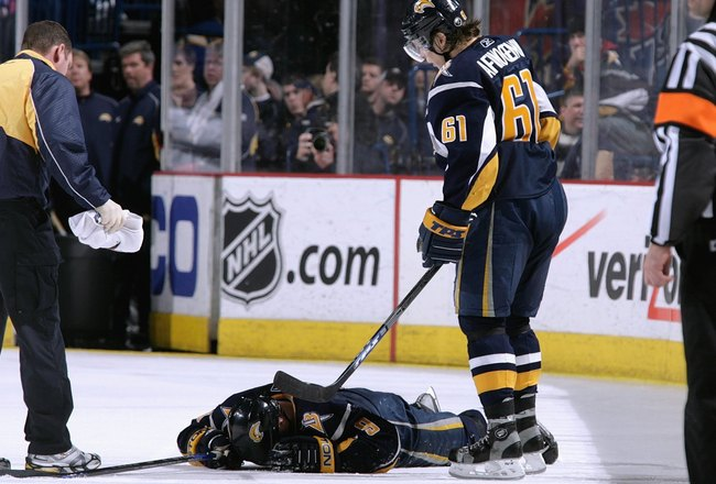 BUFFALO, NY - MARCH 25:  Maxim Afinogenov #61 of the Buffalo Sabres stands over Derek Roy #9, who was injured during the game against the Ottawa Senators on March 25, 2008 at HSBC Arena in Buffalo, New York. (Photo by Rick Stewart/Getty Images)