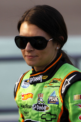 HOMESTEAD, FL - NOVEMBER 20:  Danica Patrick, driver of the #7 GoDaddy.com Chevrolet, stands on the grid prior to the NASCAR Nationwide Series Ford 300 at Homestead-Miami Speedway on November 20, 2010 in Homestead, Florida.  (Photo by Chris Trotman/Getty