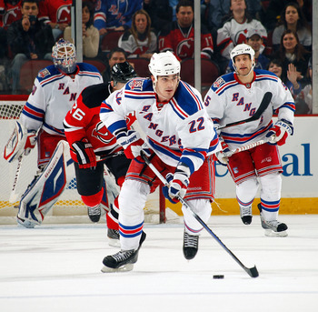 NEWARK, NJ - DECEMBER 29:  Brian Boyle #22 of the New York Rangers skates with the puck against New Jersey Devils during a game on December 29, 2010 at the Prudential Center in Newark, New Jersey. The Rangers won 3-1.  (Photo by Lou Capozzola/Getty Images