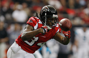 ATLANTA, GA - JANUARY 02:  Roddy White #84 of the Atlanta Falcons reaches for a catch during the game against the Carolina Panthers at the Georgia Dome on January 2, 2011 in Atlanta, Georgia.  (Photo by Scott Halleran/Getty Images)