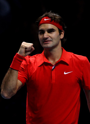 LONDON, ENGLAND - NOVEMBER 28:  Roger Federer of Switzerland celebrates victory during his men's final match against Rafael Nadal of Spain during the ATP World Tour Finals at O2 Arena on November 28, 2010 in London, England.  (Photo by Julian Finney/Getty