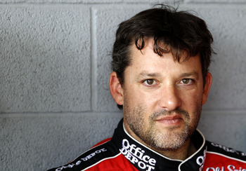 HOMESTEAD, FL - NOVEMBER 19:  Tony Stewart, driver of the #14 Old Spice/Office Depot Chevrolet, stands in the garage during practice for the NASCAR Sprint Cup Series Ford 400 at Homestead-Miami Speedway on November 19, 2010 in Homestead, Florida.  (Photo