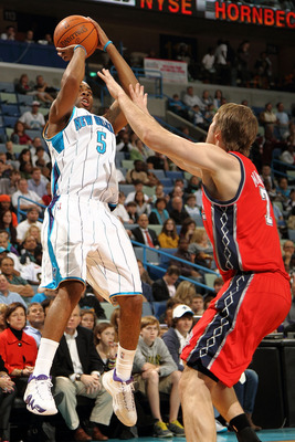NEW ORLEANS, LA - DECEMBER 22:  Marcus Thornton #5 of the New Orleans Hornets shoots the ball over Troy Murphy #7 of the New Jersey Nets at the New Orleans Arena on December 22, 2010 in New Orleans, Louisiana.  The Hornets defeated the Nets 105-91.   NOTE