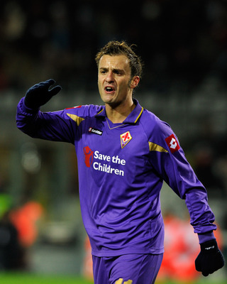TURIN, ITALY - NOVEMBER 27:  Alberto Gilardino of ACF Fiorentina reacts during the Serie A match between Juventus and Fiorentina at Olimpico Stadium on November 27, 2010 in Turin, Italy.  (Photo by Claudio Villa/Getty Images)