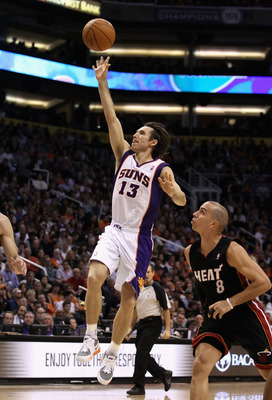 PHOENIX - DECEMBER 23:  Steve Nash #13 of the Phoenix Suns puts up a shot against the Miami Heat during the NBA game at US Airways Center on December 23, 2010 in Phoenix, Arizona. NOTE TO USER: User expressly acknowledges and agrees that, by downloading a
