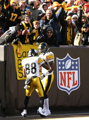 CLEVELAND, OH - JANUARY 02:  Wide receiver Mike Wallace #17 of the Pittsburgh Steelers celebrates after scoring a touchdown with Emmanuel Sanders #88 against the Cleveland Browns at Cleveland Browns Stadium on January 2, 2011 in Cleveland, Ohio.  (Photo b