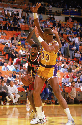 LOS ANGELES - 1988:  Mark Bryant #2 of the Portland Trail Blazers drives around Kareem Abdul-Jabbar #33 of the Los Angeles Lakers during the 1988-1989 NBA season game at the Great Western Forum in Los Angeles, California.  (Photo by: Tim Defrisco/Getty Im