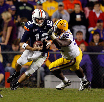 BATON ROUGE, LA - OCTOBER 24:  Quarterback Chris Todd #12 of the Auburn Tigers is sacked by Drake Nevis #92 of the Louisiana State University Tigers at Tiger Stadium on October 24, 2009 in Baton Rouge, Louisiana.  (Photo by Chris Graythen/Getty Images)