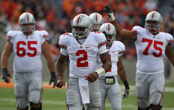 CHAMPAIGN, IL - OCTOBER 02: Terrelle Pryor #2 of the Ohio State Buckeyes leads teammates including Justin Boren #65, Dan Herron #1 and Mike Adams #75 off the field during a game against the Illinois Fighting Illini at Memorial Stadium on October 2, 2010 i