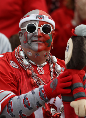CHAMPAIGN, IL - OCTOBER 02: A fan of the Ohio State Buckeyes watches as his team takes on the Illinois Fighting Illini at Memorial Stadium on October 2, 2010 in Champaign, Illinois. Ohio State defeated Illinois 24-13. (Photo by Jonathan Daniel/Getty Image