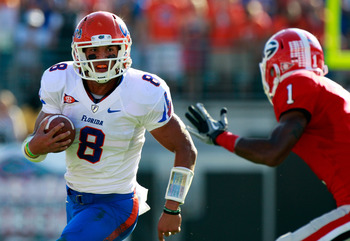 JACKSONVILLE, FL - OCTOBER 30:  Quarterback Trey Burton #8 of the Florida Gators attempts to run past Branden Smith #1 of the Georgia Bulldogs during the game at EverBank Field on October 30, 2010 in Jacksonville, Florida.  (Photo by Sam Greenwood/Getty I