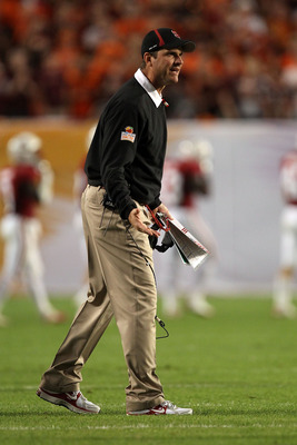 MIAMI, FL - JANUARY 03:  Head coach Jim Harbaugh of the Stanford Cardinal reacts as he coaches against the Virginai Tech Hokies during the 2011 Discover Orange Bowl at Sun Life Stadium on January 3, 2011 in Miami, Florida.  (Photo by Streeter Lecka/Getty