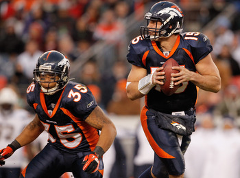 DENVER, CO - JANUARY 2:  Quarterback Tim Tebow #15 of the Denver Broncos drops back to pass as running back Lance Ball #35 looks to make a block against the San Diego Chargers at INVESCO Field at Mile High on January 2, 2011 in Denver, Colorado. (Photo by