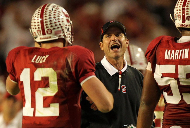 MIAMI, FL - JANUARY 03:  Head coach Jim Harbaugh of the Stanford Cardinal celebrates a play with Andrew Luck #12 against the Virginai Tech Hokies during the 2011 Discover Orange Bowl at Sun Life Stadium on January 3, 2011 in Miami, Florida. Stanford won 4