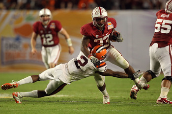 MIAMI, FL - JANUARY 03:  Stepfan Taylor #33 of the Stanford Cardinal runs the ball against Davon Morgan #2 of the Virginai Tech Hokies during the 2011 Discover Orange Bowl at Sun Life Stadium on January 3, 2011 in Miami, Florida.  (Photo by Streeter Lecka