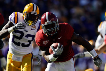 BATON ROUGE, LA - NOVEMBER 06:  Trent Richardson #3 of the Alabama Crimson Tide avoids a tackle by Stefoin Francois #23 of the Louisiana State University Tigers at Tiger Stadium on November 6, 2010 in Baton Rouge, Louisiana.  (Photo by Chris Graythen/Gett