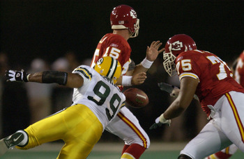 CANTON, OH - AUGUST 4:  Quarterback Todd Collins #15 of the Kansas City Chiefs fumbles as he is hit by defensive end Jamal Reynolds #99 of the Green Bay Packers during the Hall of Fame game at Fawcett Stadium on August 4, 2003 in Canton, Ohio.  The Chiefs