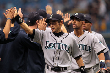 ST PETERSBURG, FL - SEPTEMBER 26: Ichiro Suzuki #51 of the Seattle Mariners celebrates a 6-2 win with teammates against the Tampa Bay Rays at Tropicana Field on September 26, 2010 in St. Petersburg, Florida. (Photo by Eliot J. Schechter/Getty Images)