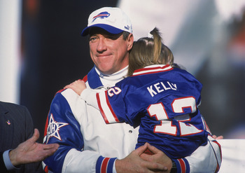 18 Nov 2001:  Quarterback Jim Kelly #12 of the Buffalo Bills holding his daughter during Jim Kelly's Retirement Ceremony before the game against the Seattle Seahawks at the Ralph Wilson Stadium in Orchard Park, New York. The Seahawks defeated the Bills 23