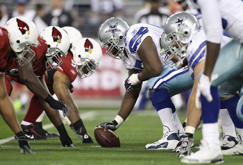 GLENDALE, AZ - DECEMBER 25:  Center Andre Gurode #65 of the Dallas Cowboys prepares to snap the ball against the Arizona Cardinals during the NFL game at the University of Phoenix Stadium on December 25, 2010 in Glendale, Arizona. The Cardinals defeated t