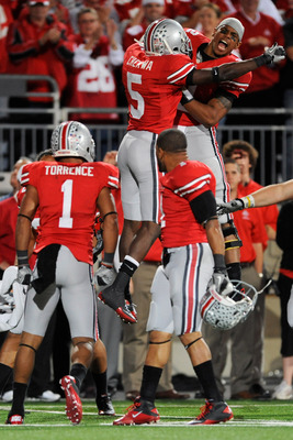 COLUMBUS, OH - NOVEMBER 13:  Quarterback Terrelle Pryor #2 of the Ohio State Buckeyes celebrates with Chimdi Chekwa #5 of the Ohio State Buckeyes after Devon Torrence returned an interception 34-yards for a touchdown against the Penn State Nittany Lions a