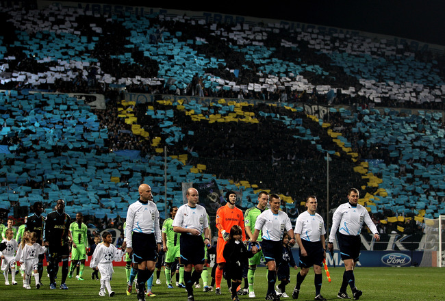 MARSEILLE, FRANCE - DECEMBER 08:  The officials lead ou the teams prior to kickoff during the UEFA Champions League Group F match between Marseille and Chelsea at the Stade Velodrome on December 8, 2010 in Marseille, France.  (Photo by Michael Steele/Gett