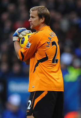 BOLTON, ENGLAND - NOVEMBER 20:  Jussi Jaaskelainen of Bolton Wanderers in action during the Barclays Premier League match between Bolton Wanderers and Newcastle United at the Reebok Stadium on November 20, 2010 in Bolton, England.  (Photo by Laurence Grif