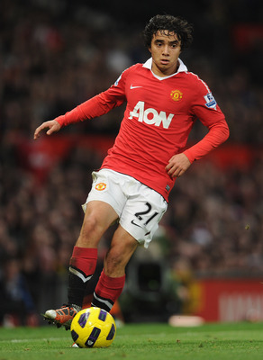 MANCHESTER, ENGLAND - NOVEMBER 20: Rafael Da Silva of Manchester United plays the ball during the Barclays Premier League match between Manchester United and Wigan Athletic at Old Trafford on November 20, 2010 in Manchester, England.  (Photo by Michael Re